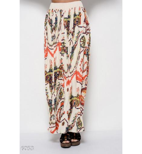 Бежевая длинная юбка в пол с плиссировкой и принтом